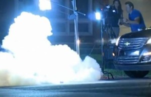 A still image taken from raw http://www.thewrap.com/police-tear-gas-not-fired-at-al-jazeera-news-crew-intentionally-video/ shows an Al-Jazeera new team covering protests being tear-gassed by Ferguson police.  When the team members fled, a SWAT team dismantled the equipment setup.